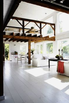 Open rustic space with modern white floors.