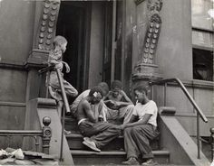 Gordon Parks - Boys playing cards on front steps of apartment building in Harlem, 1948
