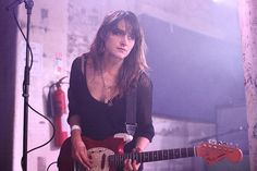 Theresa Wayman. Warpaint. Red Fender Mustang.