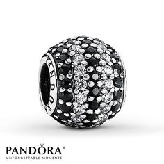 Alternating rows of round black crystals and clear cubic zirconias embellish this sterling silver charm from the Summer 2013 collection from Pandora. Style # 791172NCK.