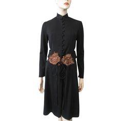 Vintage 1970s designer Anthony Muto black dress with pheasant feather belt. Wonderful 70s does 40s look to this timeless classic designer dress. ---#vintagebeginshere at www.rubylane.com @rubylanecom #fallfashion #vintagefashion #getthelook