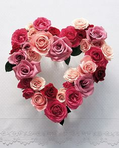 Who *doesn't* want to receive roses on #Valentine's Day?  We love this pretty heart #wreath made of fresh roses....