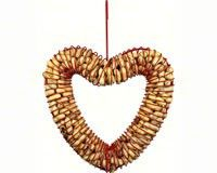 Heart Peanut Bird Feeder. This red heart shaped bird feeder holds peanuts in the shell. It is pleasing to the eye as well as to the birds. Large birds love the large peanuts. You can also fill it with suet balls.