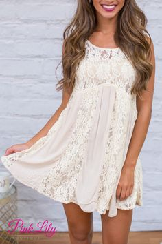 This adorable and romantic lace dress is simply a must-have for your wardrobe! The bodice has stunning ivory lace, a scoopneck, and a keyhole cutout in back!