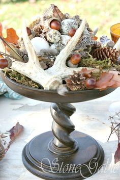 FALL WOODLAND TABLESCAPE - StoneGable  add tall feathers ,  on cake stands , wooden slice on stand as background