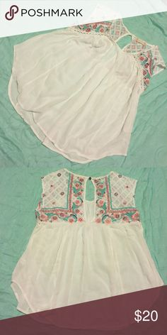 Altar'd State white short sleeve The perfect colors for spring are showcased on the adorable floral accents of this top! Eyelet cutout on the back. Loose fit so this can easily fit larger or smaller sizes! Altar'd State Tops Tees - Short Sleeve