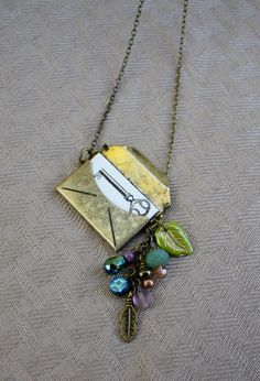 Secret Message Necklace - Gold Letter Locket with Charms on Chain. $27.00, via Etsy.