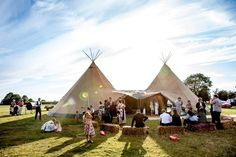 A cosy and intimate tipi wedding for Emily and Leigh at Mannings Farm in Northamptonshire. Their spokes-of-a-wheel table layout, dressed with snug reindeer hides and a rustic naked cake in the centre were just perfect. And squidgy, giant marshmallows to toast as favours - yes please! Tipis by Beautiful World Tents, photography by aarontommasi.com