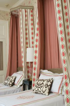 Osborne & Little printed linen bed drapery panels, with a nice repetition of the colors in the rest of the bedding.   Melissa Miles Rufty
