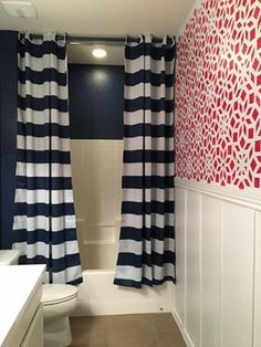A DIY stenciled accent wall in a red, white, and navy blue bathroom using the Kerala Allover Stencil, a geometric Indian inspired wall pattern, from Cutting Edge Stencils. http://www.cuttingedgestencils.com/kerala-indian-stencil-geometric-pattern-stencils.html