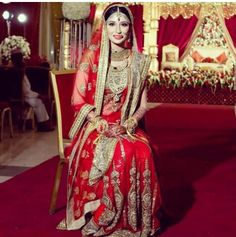Indian bride in red and gold Sabyasachi lehenga