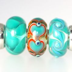 Trollbeads Gallery - Twins and Trios! Look at this beauty of a heart bead!  SO rare and catching! http://www.trollbeadsgallery.com/twins-trios-114/