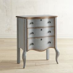 """Question: Where in your home do you see our classic keyhole chest fitting in best? Its dove gray finish with golden accents would look great most anywhere. And it's the right size for smaller spaces. Maybe in the entryway, as a handy first and last stop when you come and go. Or in your bath for additional storage. And it could really dress up your home office and help conquer the clutter. Seems the answer is """"all of the above."""""""