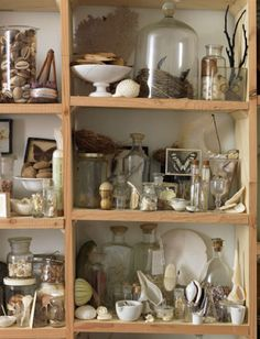 I love clusters of collections. I have many..too many I'm sure. I love this open set of shelves with seemingly random items but look closely and you'll see the theme and the deceptively casual arrangement. Sibella Court's office/workspace.