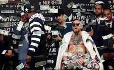 Floyd Mayweather Jr rains dollar notes on Conor McGregor in promotional event, watch video