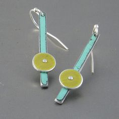 """""""Dorthy"""" by Pyper Hugo ... earrings are handmade using metal salvaged from a 55 Ford Fairlane and a piece off an old airplane. Both colors are the original paint left intact and unaltered. ... Ear wires are sterling silver. The total length including the ear wire is approximately 1 1/2"""" long."""