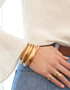 My mother has always had the most beautiful gold bangles, and seeing them on her certainly left an impression on me. I've been collecting gold bangles since high school—you can never have too many, and in my opinion they never go out of style.