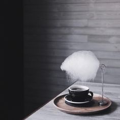 freshly spun cotton candy, set over a hot cup of americano. the sugar will literally rain down, giving the coffee a delightful, yet extremely subtle sweetness.