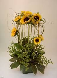 A gallery of unique floral arrangements created by the talented designers at Martin's, the Flower People. Sunflower Wedding Decorations, Sunflower Centerpieces, Sunflower Arrangements, Tall Centerpiece, Centerpiece Wedding, Modern Floral Arrangements, Wedding Flower Arrangements, Inexpensive Wedding Flowers, Altar Flowers