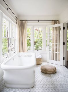 Pretty bathtub & hexagon tiled floors