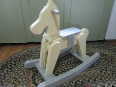 Custom made rocking horse painted with Shabby Chic Farm Chalk Paint. Yellow and Chateau Gray!
