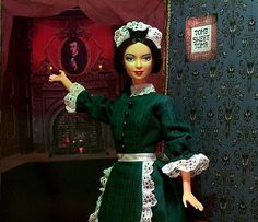 barbie dressed up as a cast worker on haunted mansion! friggin' sweet!