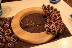 free pinecone wreath, crafts, seasonal holiday decor, wreaths, It took a little patience but it was easy enough Just keep gluing and gluing
