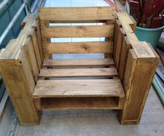 Pallet or Crate Chair. My husband is going to be all over this idea!