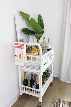 Happy Hour in Paradise: Summer Bar Cart Styling | House Full of Summer - Florida bar cart decor, tropical themed party, tiki bar styling, coastal decor dining room entertaining, LVP wood floors, fresh palm fronds, palm leaves, giant bird of paradise, Decorating On A Budget, Porch Decorating, Bar Cart Styling, Palm Fronds, Cozy House, Coastal Decor, Home Decor Inspiration, Happy Hour, Decor Crafts