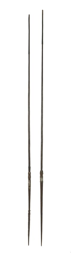 Two Solomon Islands' palm wood spears, the tips with shallow barbs, inlaid pearl shell geometric panels Sold for £650 on 1st March 2016