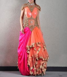 #ikhabygyans A dusty peach and hot pink gown with lots of flounce. Bold embroidery and a bold cut.
