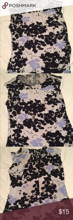 Floral Beautiful New York and Company Top Good but worn condition Top. The background is a Grey color not white. No tears or stains. Tops