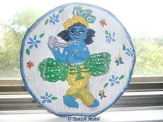 Lord Krishna made with paper mache clay