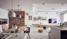 Any family would be tickled to have such a gem of a home as this one by Nordico, with cute-as-a-button accents like the deer head light adorning the master bedrooms wall, adding both ambiance and flare. The brick partition wall between the dining area and living space gives a splash of color within a vastly …