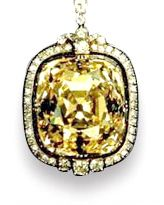 The Ashberg Diamond. It is said that this amber-colored, cushion-shaped diamond weighing 102.48 carats, was formerly part of the Russian Crown Jewels.