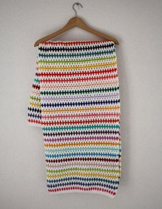 Crochet blanket ripple stitch white and rainbow by SoHappyInRed