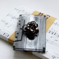 Add a musical touch to your gifts with this retro cassette tape decoration on top of them.