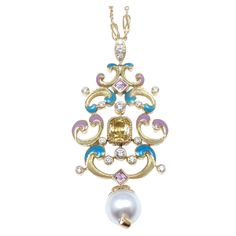 TIFFANY & CO Diamond Yellow Sapphire Pearl Enamel Gold Necklace | From a unique collection of vintage drop necklaces at http://www.1stdibs.com/jewelry/necklaces/drop-necklaces/