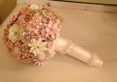 Brooch Bouquet in pink, gold, ivory, rhinestones, lace & pearls.