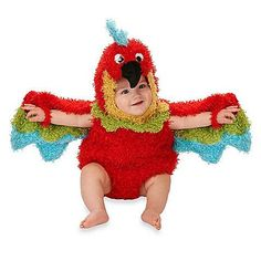 Let your little one spread their wings in this adorable Parrot costume. This brightly colored romper comes with snap closures to allow for easy diaper changes. Use the convenient thumbholes to spread the wings.