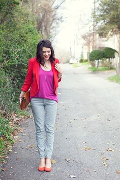 Red blazer and pink top, orange shoes, turquoise necklace