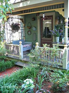 Summer on the porch - small touches of vintage collections make this porch feel welcoming.