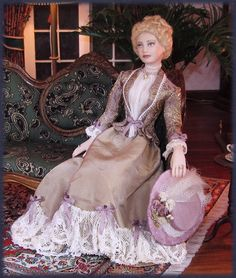 Nicole, porcelain dollhouse doll, by Annemarie Kwikkel. Dress is silk and silk brocade and lots of lace.