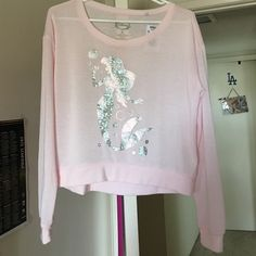 Little Mermaid long sleeve top Baby pink in color..brand new with tag..close up of tag in pic above to answer any questions about material..Disney the Little Mermaid in sparkly silver.. Disney Tops Tees - Long Sleeve