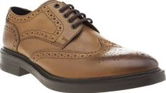 Base London Tan Manor Brogue Mens Shoes You are lord of the Manor with this brogue from Base London. The classic style is constructed with a tan leather upper featuring perforated and cut-out details. A chunky sole with rubber grip pods and http://www.comparestoreprices.co.uk/january-2017-8/base-london-tan-manor-brogue-mens-shoes.asp
