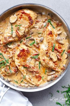 A Creamy Sun Dried Tomato Parmesan Chicken with Mushrooms that is Gluten Free and made with NO HEAVY CREAM.....or ANY cream.....at ALL! | http://cafedelites.com