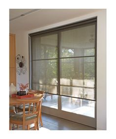 Smith & Noble Solar Roller Shades...our living room is ALL windows and the sun late in the day (western exposure) makes it very warm...love these shades.