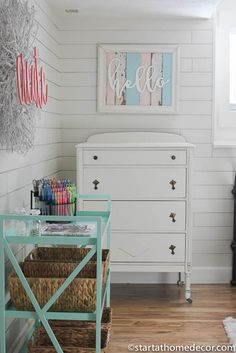 Girls room makeover.  Shiplap walls, wrought iron bed, and vintage inspired accessories.