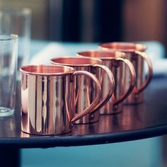 Copper mugs for Moscow Mules.  Need these.