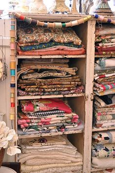 I love this. I used to store my fabrics like this but if you don't move them around regularly, they get fade lines. I made a dark brown pleated curtain to hang down the front to minimize the damage. I do love the threaded spools ...